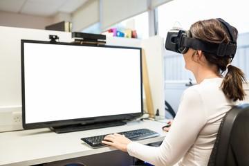 Businesswoman using oculus rift headset