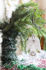 Christmas angel in tree on colorful background bokeh among Christmas and New Year decor