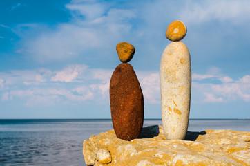 Figurines of stones on seashore