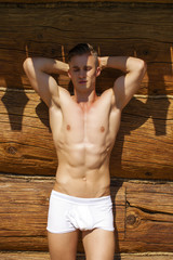 Sexy portrait of a very muscular shirtless male model