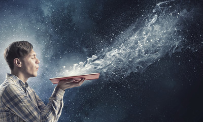 Blow dust from pages