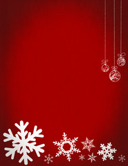 Christmas snowflakes and baubles on red background