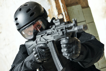 Special forces soldier armed with assault rifle ready to attack