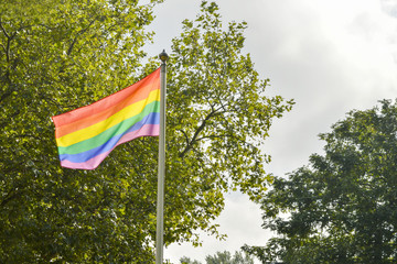 LGBT flag in front of a coffee place in the park