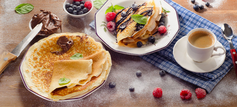 Crepes with Raspberries, Blueberries and Chocolate cream for bre