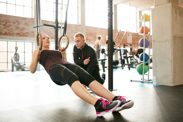 Personal trainer helping woman on her work out routines