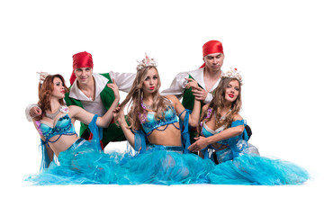 Carnival dancer team dressed as mermaids and pirates.  Isolated on white background in full length
