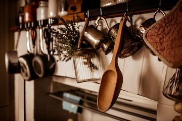 Kitchen utensils hanging on wall