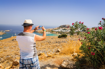 Taking photo of beautiful Rhodes landscape