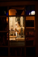 Pretty woman drinking coffee in the kitchen