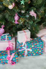 Beautifully decorated Christmas tree with many presents