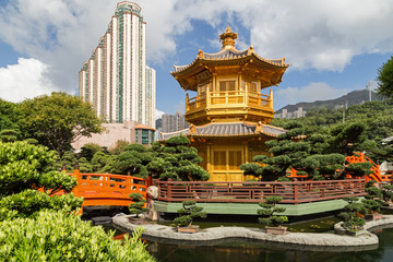 Pond, bridge and Pavilion of Absolute Perfection at the Nan Lian Garden in Hong Kong, China.
