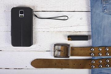 Planks, phone, lighter blue jeans and belt