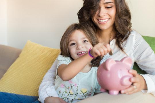 Mom and daughter saving money