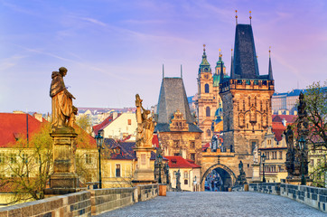 Fototapeten Prag Charles Bridge and the towers of the old town of Prague on sunrise, Czech Republic