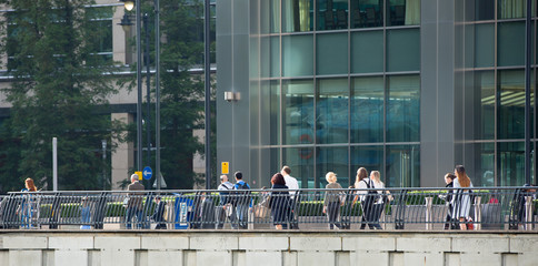 LONDON, UK - SEPTEMBER 14, 2015:  Office workers going at work. Early morning hours in Canary Wharf business life