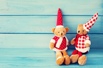 Vintage Christmas teddy bears over turquoise wood