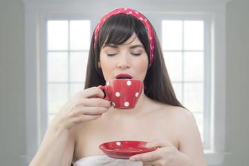Girl enjoying a cup of coffee indoors