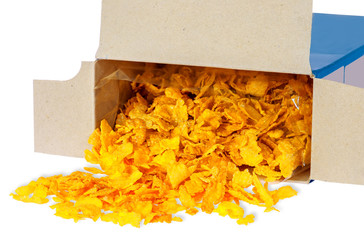 Corn flakes spill out of cardboard box