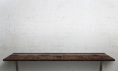 White wall texture in background. Wooden table with legs and free space.