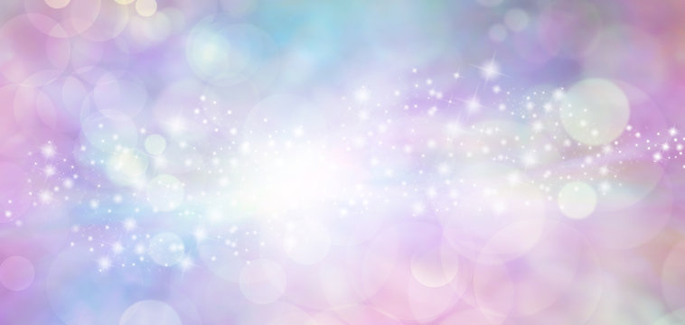 Pink and blue starry glitter feminine toned bokeh background banner - Wide pink and blue  sparkling glittery star speckled background with a whoosh of stars moving through the middle