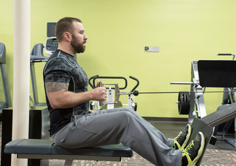 Man Using Seated Row Machine