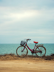 travel and relaxation concept: old bicycle at the seaside