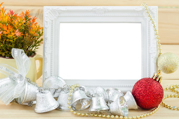 Vintage white blankk photo frame with chirstmas decorations.