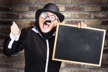 Excited headmaster holding education chalkboard