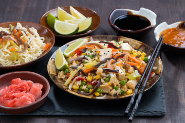 asian lunch - fried rice with tofu and vegetables