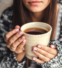 a cup of coffee in a beautiful female hands and beautiful lips