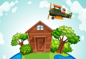 Airplane flying over a wooden house