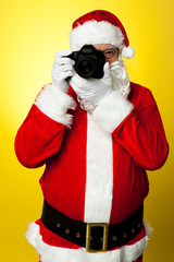 Smile please!! Santa claus clicking picture
