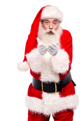 Santa claus posing with open palms over white