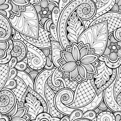 Seamless background in vector with doodles, flowers and paisley.