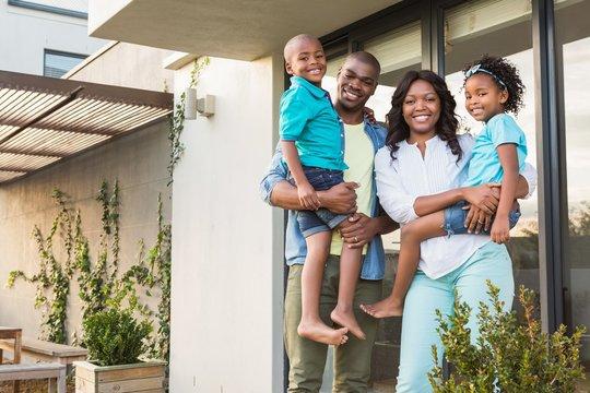 Happy african american family standing in the garden