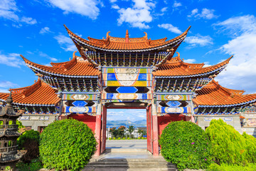 Arched  Entrance of Chinese Temple under Blue Sky and White Cloud