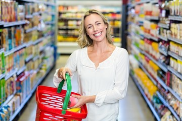 Woman buying food and smiling at the camera