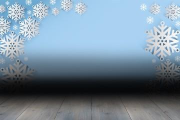 Snowflake wallpaper over floor boards