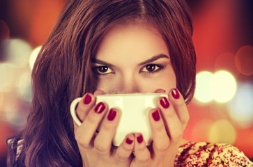 Coffee. Young beautiful Girl woman drinking Tea Cappuccino in trendy cafe shop