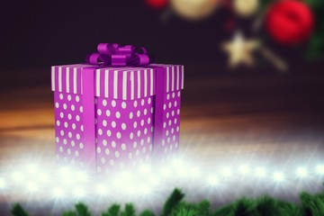 A purple Christmas gift with ribbon