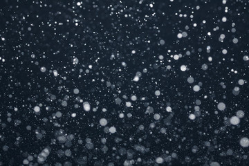Snow Falling from Night Sky