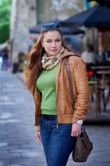 Portrait of beautiful woman with leather jacket in the city