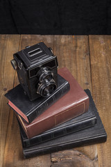 Old Camera On Books