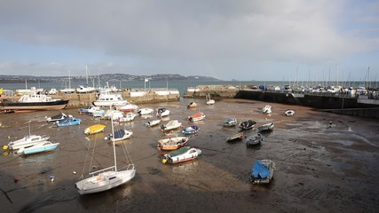 Wall Mural - Paignton harbour Devon England uk boats low tide view towards Torquay pan