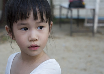 Asian girl with white t-shirt staring at