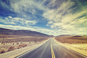 Vintage stylized endless country highway in Death Valley, USA.