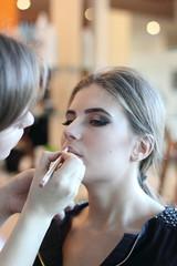 Closeup  of a woman having applied makeup by makeup artist