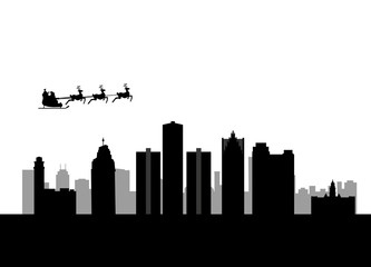 santa flying over the city of detroit