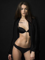Beautiful and sensual girl portrait wearing black lingerie and cardigan